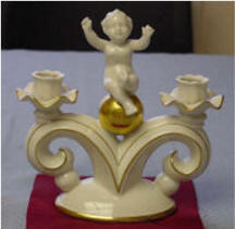 5089/D Cherub Sitting on Gold Ball Between 2 Candleholders