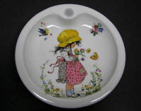 Baby Warming Dish depicting Girl Holding Flowers