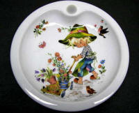 Baby Warming Dish depicting Boy with Flower Wagon