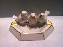 3 Birds Sitting on Edge of Ashtray