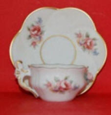 Tea cup and saucer roses pattern